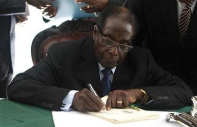 Zimbabwe President Robert Mugabe signs Zimbabwe's new constitution into law in the capital Harare